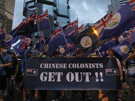 tens-of-thousands-turn-out-for-pro-democracy-march-on-anniversary-of-hong-kong-handover-photos