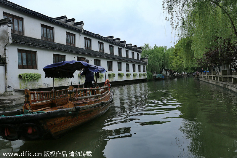 10. Zhouzhuang near Suzhou in Jiangsu province is one of the few places where one can experience the life of a typical Chinese water town. The traditional residences in the town, mostly built in the Ming and Qing dynasties (1644-1911), flank the winding waterways. Many of them are well-kept and have preserved their original appearances, with white walls and black-tiled roofs.