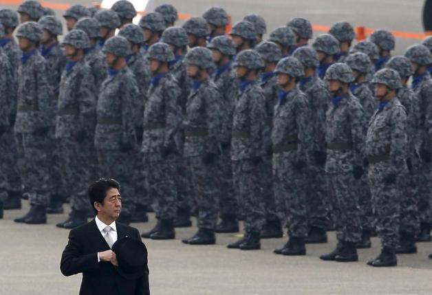 Japan's Prime Minister Shinzo Abe reviews members of Japan Self-Defense Force (JSDF) during the JSDF Air Review, to celebrate 60 years since the service's founding, at Hyakuri air base in Omitama, northeast of Tokyo, in this October 26, 2014 file photo. REUTERS/Toru Hanai/Files