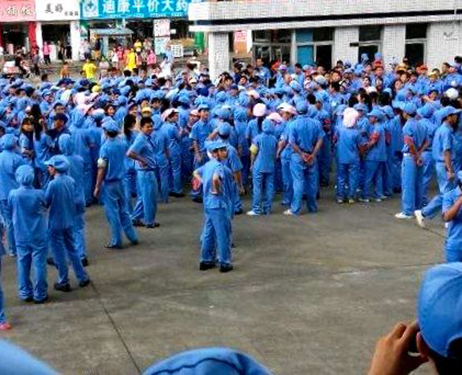 Workers at a plant in Dongguan