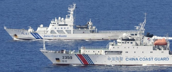 TOKYO, Japan - CORRECTING CHINESE SHIP'S NAME Photo taken from a Kyodo News airplane shows the China Coast Guard's Haijing 2350 and the Japan Coast Guard's patrol ship Hateruma in Japanese territorial waters southeast of Minamikojima, one of the five main islands in the Japanese-controlled Senkaku group, in the East China Sea on Sept. 10, 2013. (Kyodo)