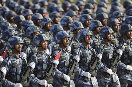 Soldiers from the Chinese People's Liberation Army (PLA) Navy Marine Corps march in formation during a training session at the 60th National Day Parade Village in the outskirts of Beijing in this September 15, 2009 file photo. REUTERS/Joe Chan