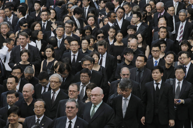 Hong Kong lawyers march in a Hong Kong street, Friday, June 27, 2014. Hundreds of Hong Kong lawyers dressed in black have marched in silence to protest a recent Beijing policy statement they say undermines the Asian financial hub's rule of law. (AP Photo/Vincent Yu)